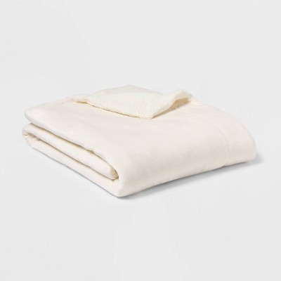 Solid Plush Reversed to Sherpa Throw Blanket Cream - Threshold™