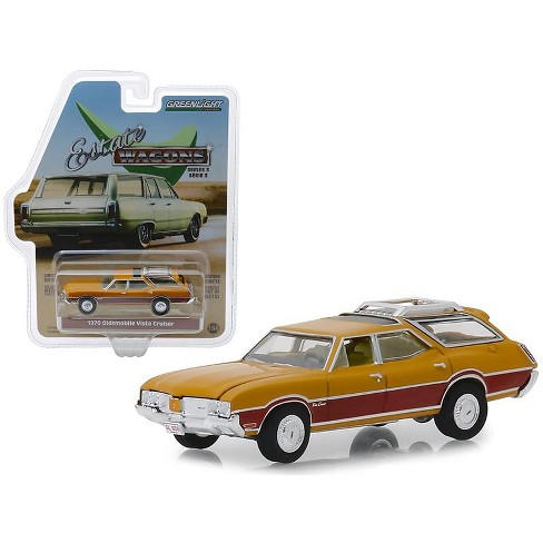 1970 Oldsmobile Vista Cruiser with Wood Grain Paneling and Roof Rack Nugget Gold 1/64 Diecast Model Car by Greenlight - image 1 of 1