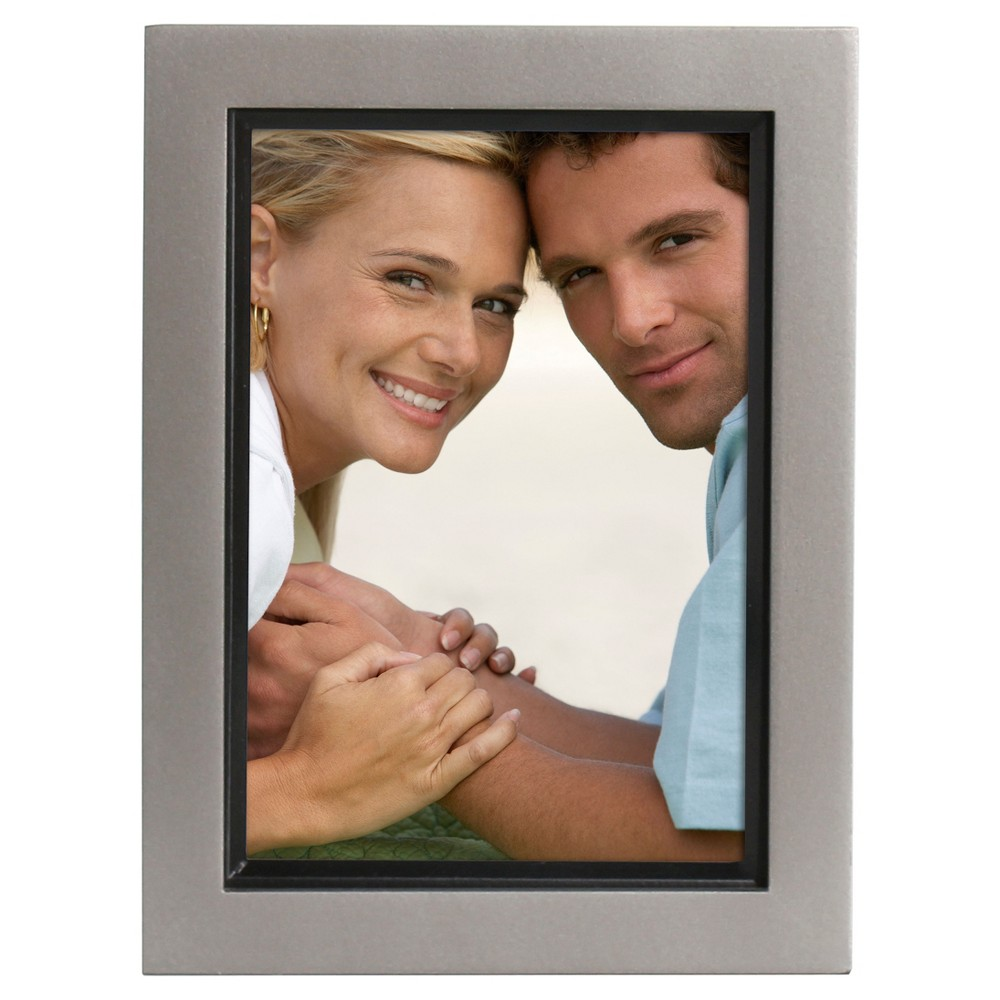 Frame Set Pewter (Silver) 5 x7  4pk - Uniek Muse 5x7 pewter and black wood picture frames are packaged conveniently in a set of 4. The classic two toned finish of these photo frames will display your pictures in beautiful contemporary style. Each of these picture frames holds one photo, is constructed with hooks already attached for wall display and an easel for tabletop display, and can be displayed horizontally or vertically.