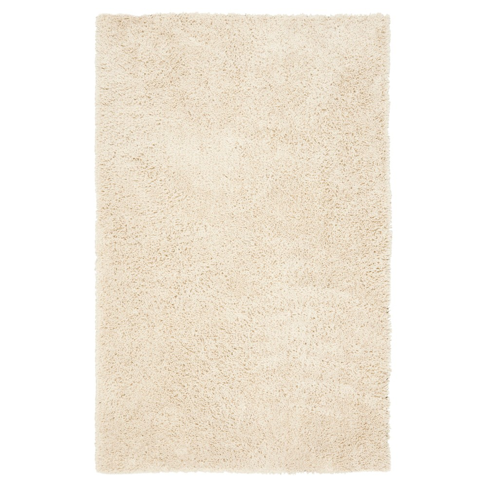 White Solid Tufted Area Rug - (6'x9') - Safavieh