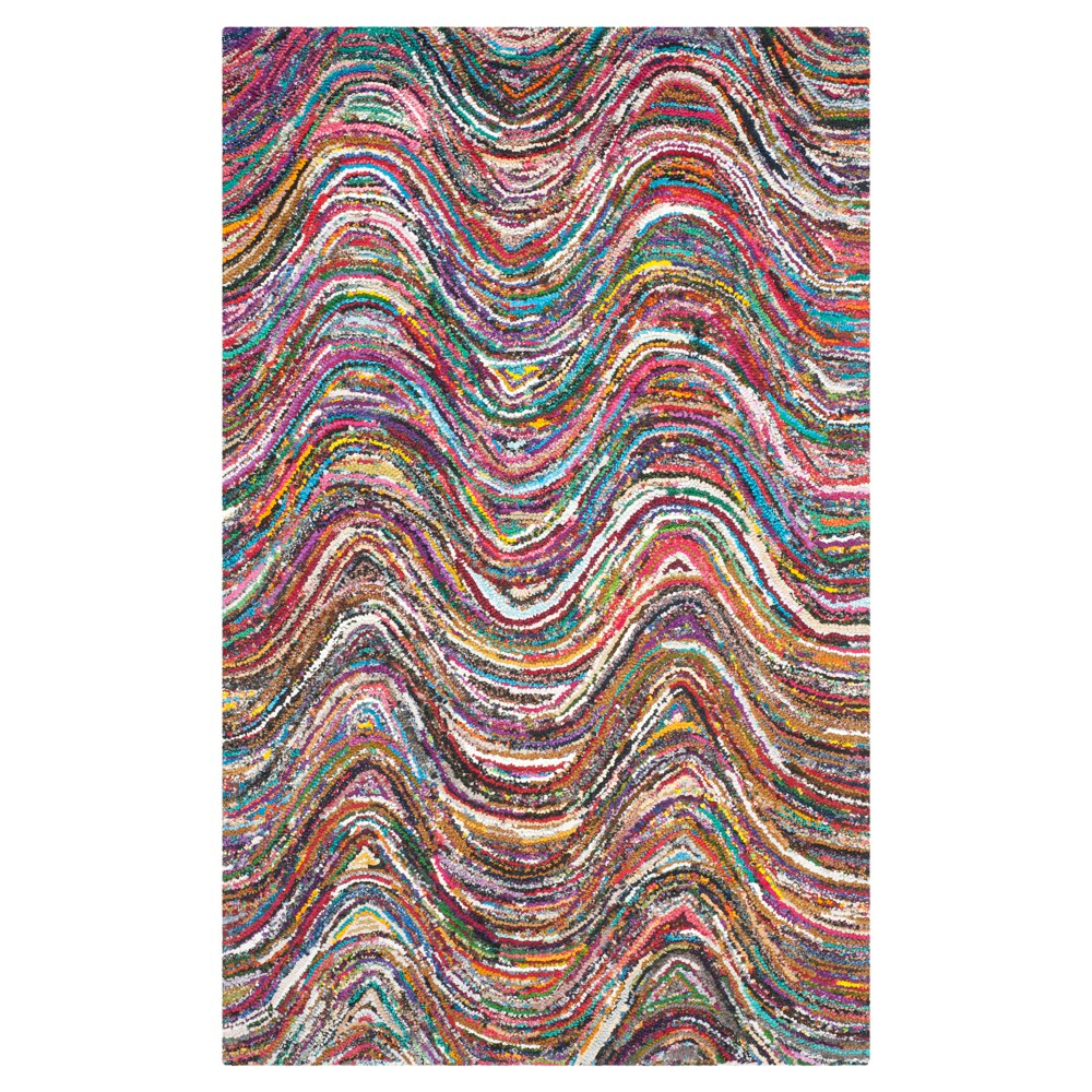 Solid Tufted Area Rug - (5'x8') - Safavieh, Multi-Colored