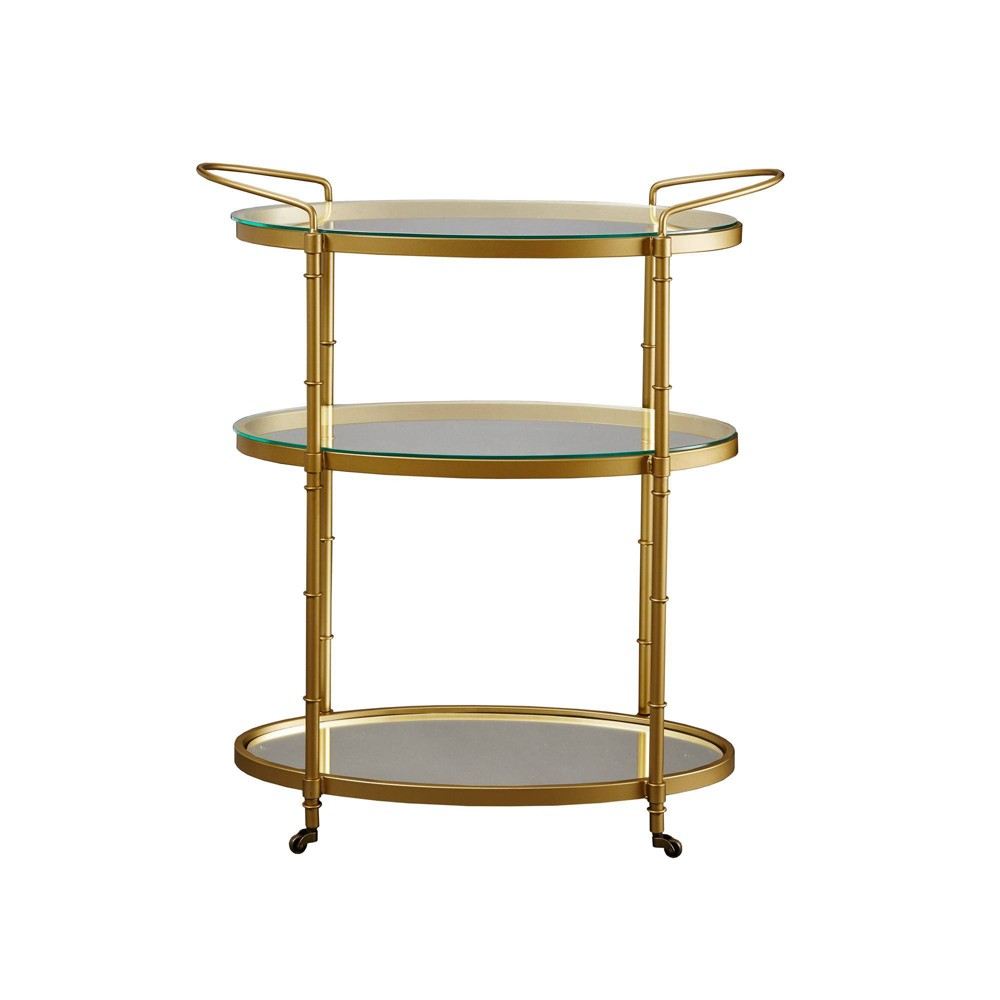 Impress your guests with the 1930?s inspired Lauren Bar Cart. This three tier metal bar cart features two 5mm tempered glass top for the top bunks and an antique mirror top for the bottom bunk. Finishing off the metal in a vibrant gold, this will be the statement piece to your living space decor. Assembly required.