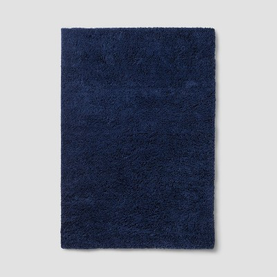 Navy Solid Tufted Washable Area Rug 7'X10' - Room Essentials™