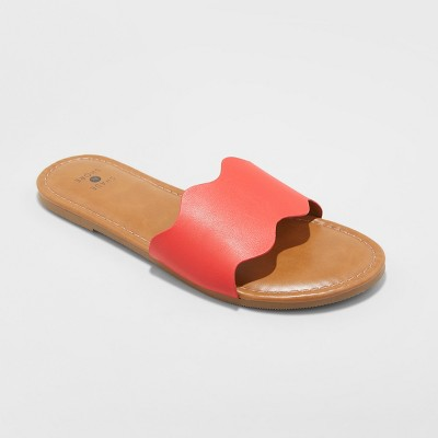 view Women's Kate Scalloped Slide Sandals - Shade & Shore on target.com. Opens in a new tab.