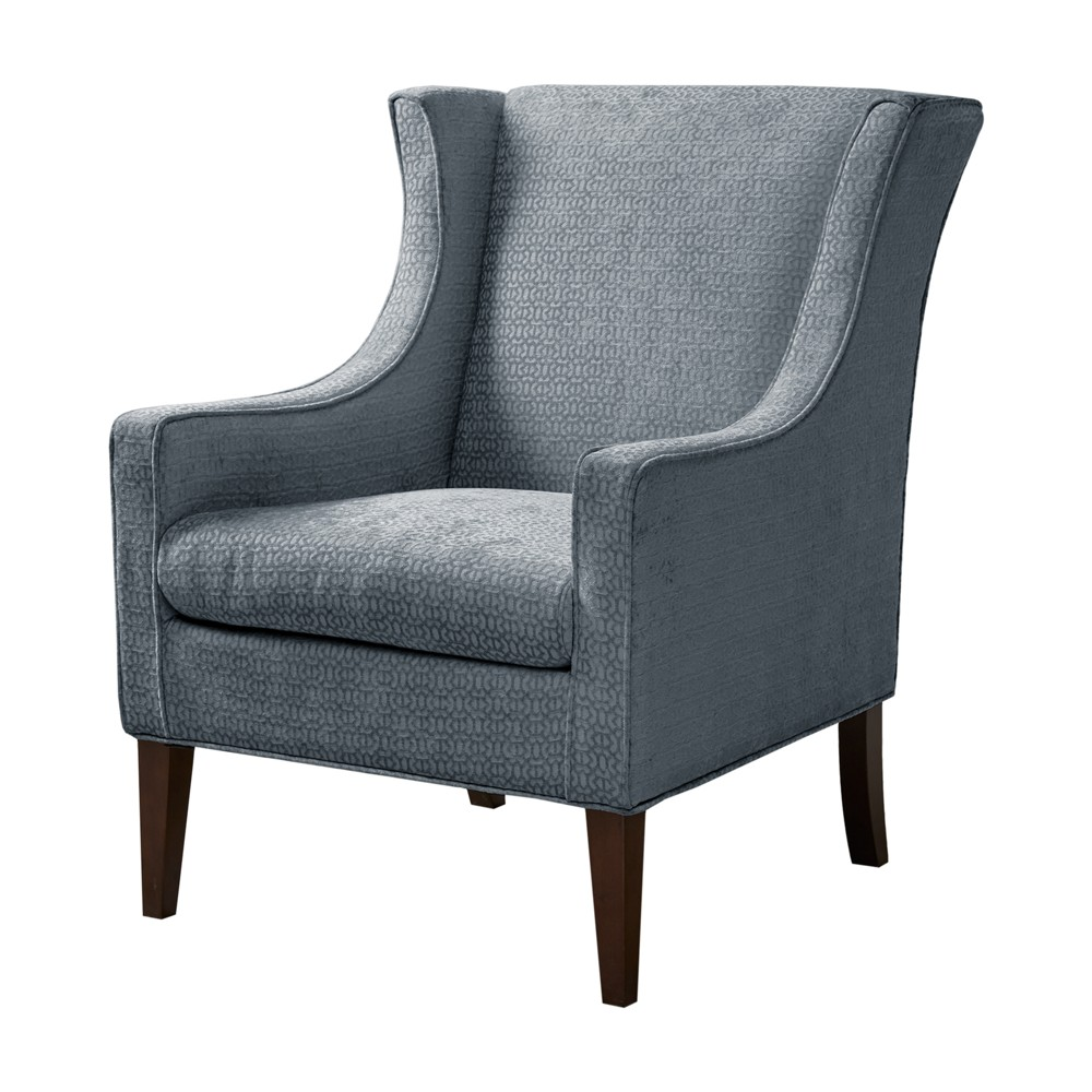 Update your living room decor with the Conway Wing Chair. This transitional accent chair will charm your living room with its sleek lines and upholstery in a warm blue hue. Its frame is made from select hardwoods and plywood that is held up by birch wooden legs to further elevate the transitional lifestyle. Leg assembly required. Pattern: Solid.