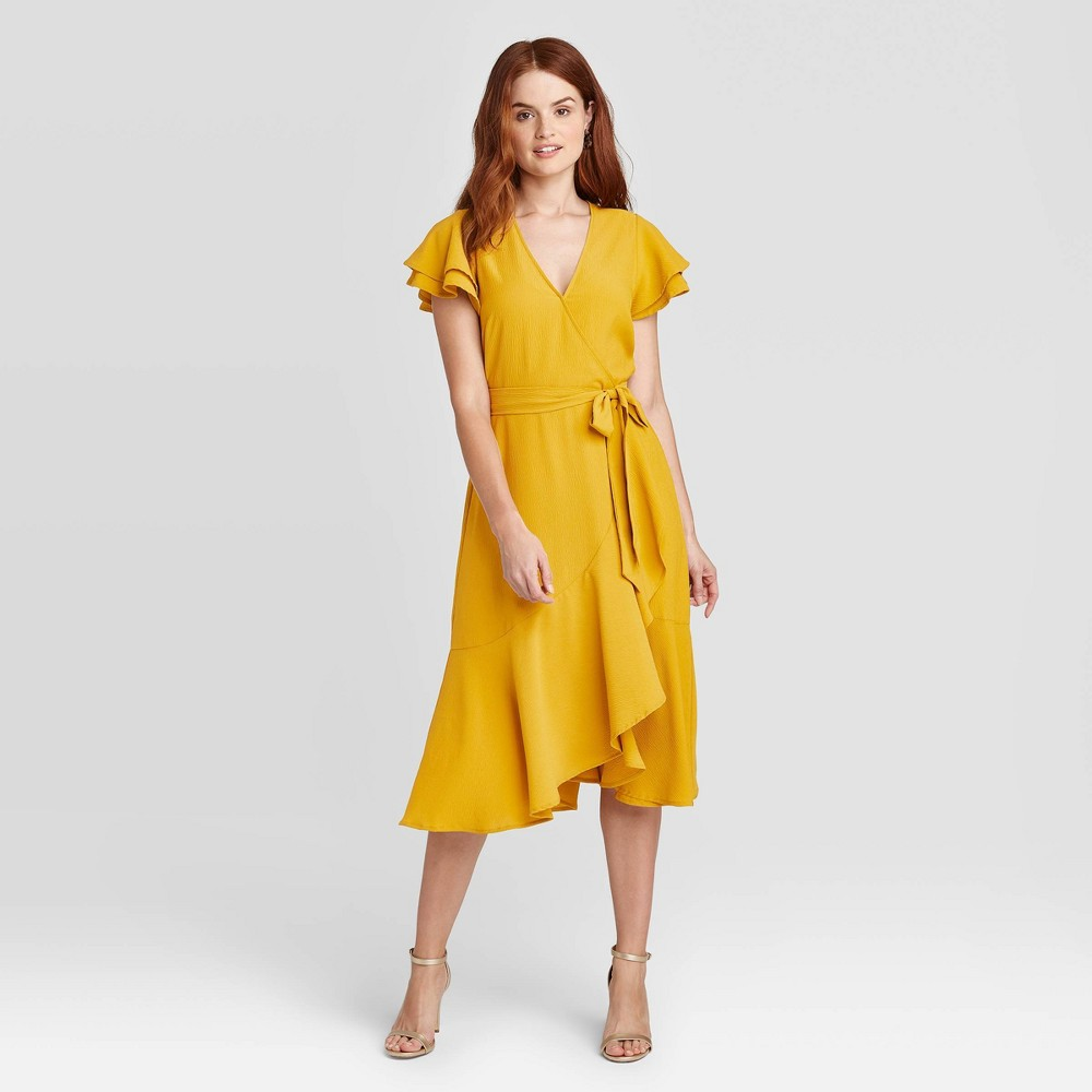 Take on the warm-weather in chic style with this Ruffle Short-Sleeve Wrap Dress from A New Day™. Crafted with flowy flutter sleeves and soft hemline ruffles to lend a flattering look you\'ll love, this textured V-neck dress is the answer to all your warm-weather party needs. You\'ll love how the soft fabric creates a comfortable feel, while the V-neckline and side-tie detailing at the waist add to the overall stylish flair. Complete your look with sneakers and hoop earrings for a casual daytime look, or with heels for a more dressy occasion. Size: XXL. Color: Gold. Gender: female. Age Group: adult. Pattern: Solid. Material: Polyester.