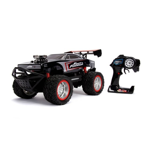 Jada Toys Fast & Furious Elite Off-Road RC 1970 Dodge Charger R/T Remote Control Vehicle with Light Up Logo 1:12 Scale Glossy Black - image 1 of 4