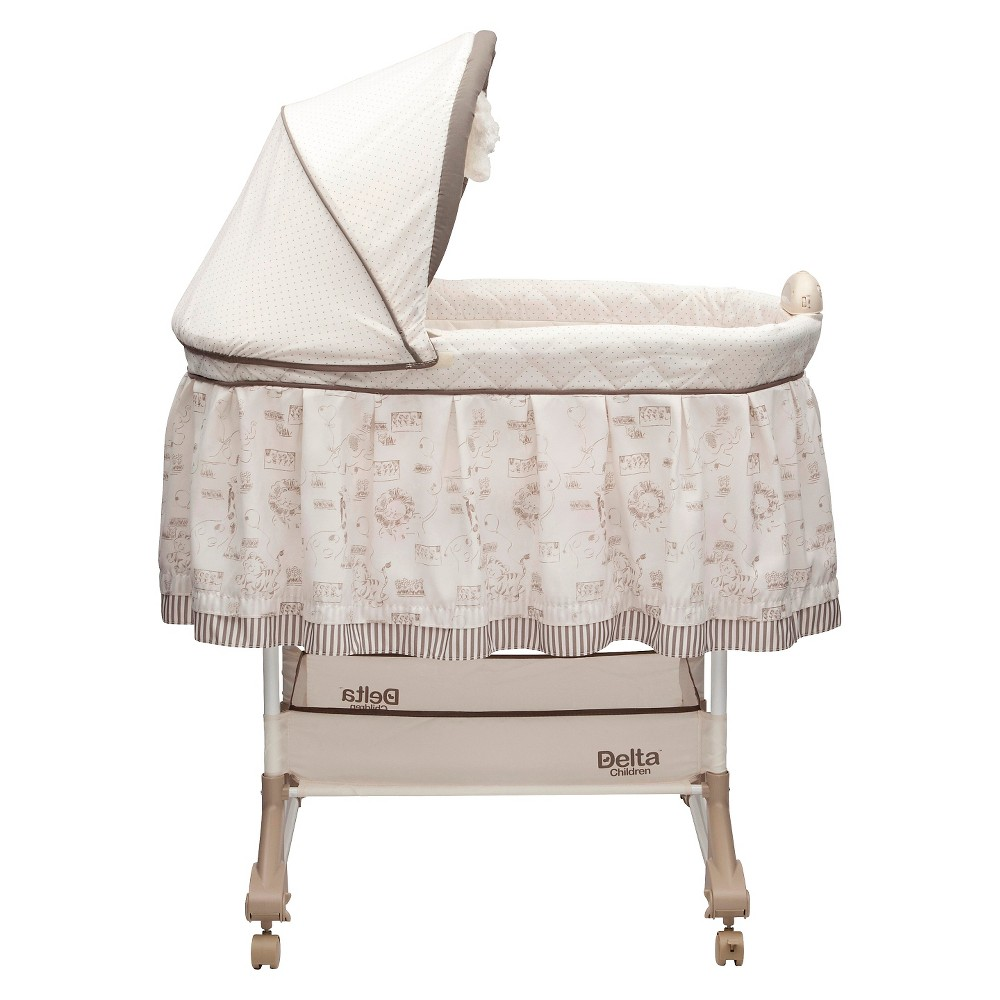 Image of Delta Children Play Time Rocking Bassinet - Jungle, Beige