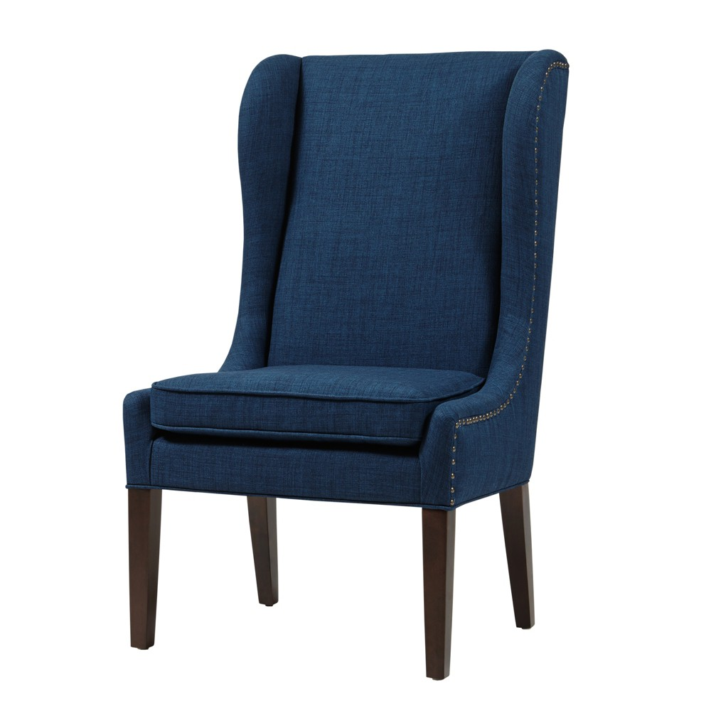 Everyone will want to join you for dinner when you have this London Dining Chair from JLA. To sit in complete comfort while eating your meal is hard to come by, but it comes naturally for this cushioned dining chair. When you have guests, you can even use this for extra seating around your living room. Color: Navy. Pattern: Solid.
