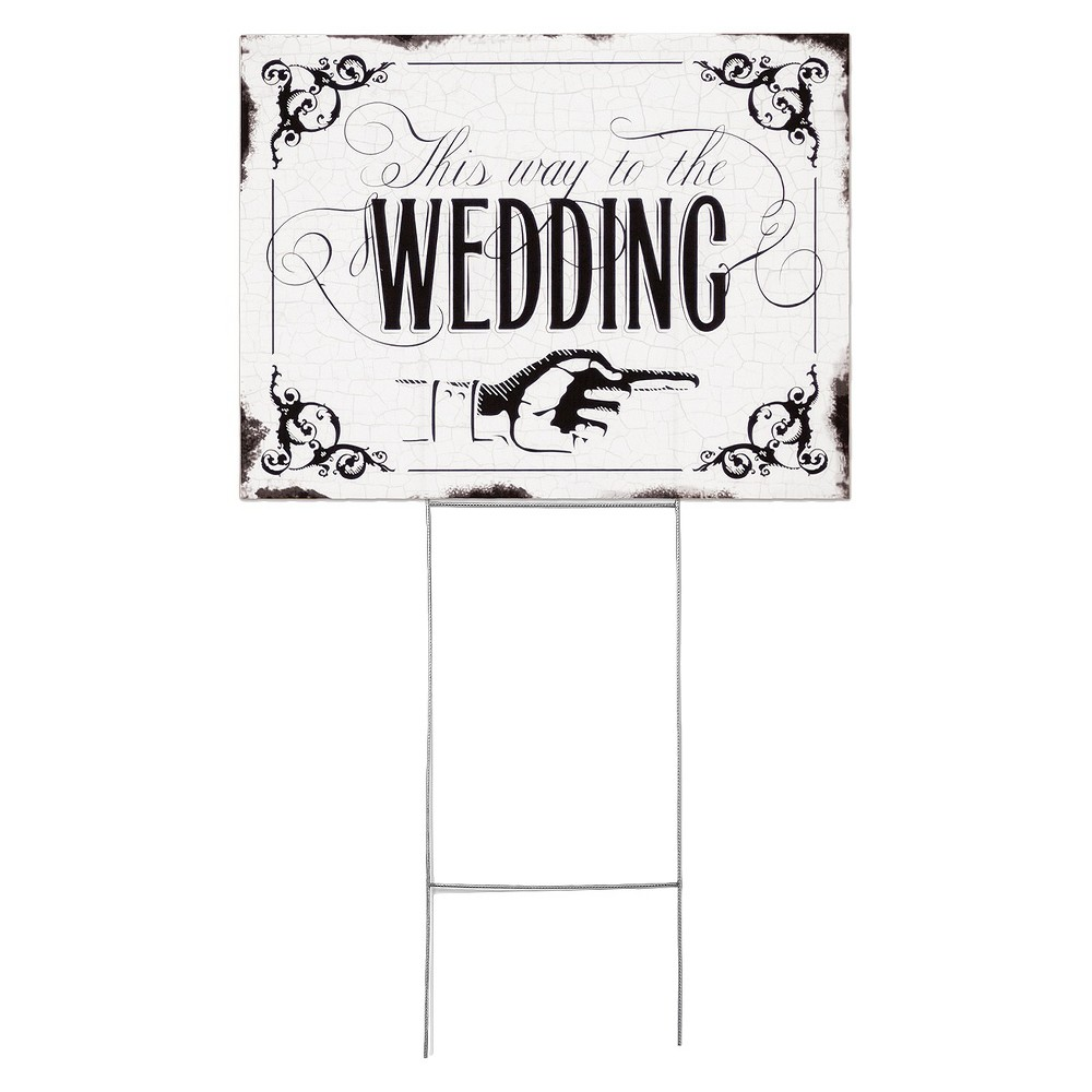 """Wedding Yard Sign -  This Way To The Wedding  Make your wedding day extra special and easy as can be by pointing your guests where to go with this this Wedding Yard Sign from Hortense B. Hewitt. Featuring the message """"This way to the Wedding"""" in black calligraphy and a classic pointing hand surrounded by a vintage-style border, this two-sided yard sign is perfect to point your wedding guests to the right direction. A must-have wedding day accessory, this ready-to-use waterproof wedding sign comes with sturdy metal stakes for easy placement in the ground."""