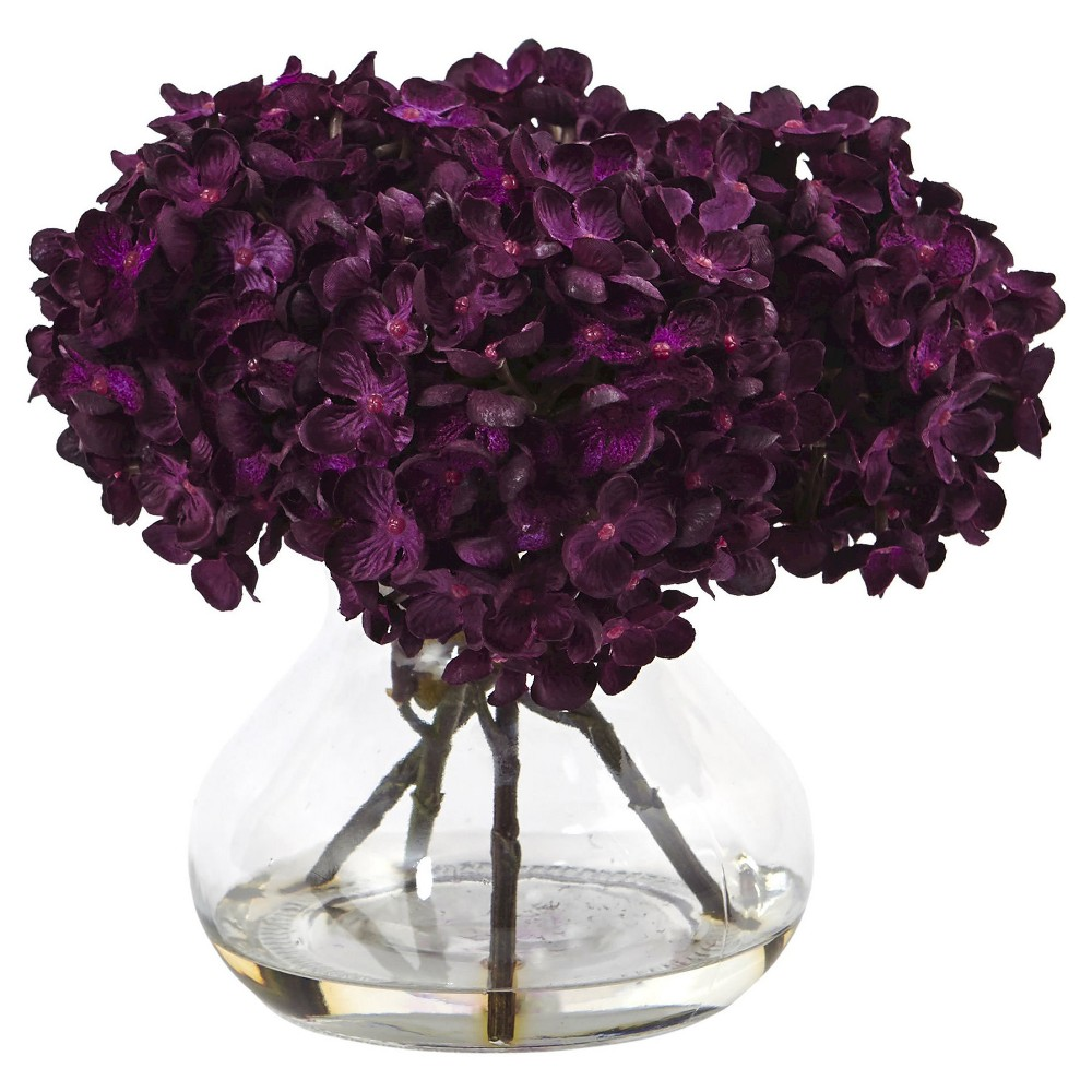 8.5H Hydrangea Silk Flower Arrangement with Glass Vase - Nearly Natural, Purple Petite blooming hydrangea bundles in brilliant autumnal colors welcome the new season. Handcrafted and finely shaped, the mixed hues of this arrangement mimic a true hydrangea. With leafy green stems and faux water vase, this arrangement is ready for display. Place the flowers next to candles and books for the perfect coffee table vignette. Color: Purple.