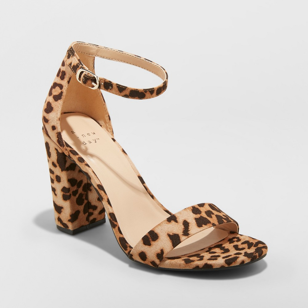 A shoe can make or break a look, so be sure to make your ensemble with the Ema High-Heeled Block Pumps from A New Day™. A leopard print adorns these block heels for the coolest touch of sassy style, and you'll love the subtly dainty look of a single strap across the sole and around the ankle. The block design makes for both an on-trend design and a sturdier base, giving you a pair of heels you can rock in both comfort and ferocious style. Size: 8.5 Wide. Color: Brown. Gender: female. Age Group: adult. Pattern: Leopards.
