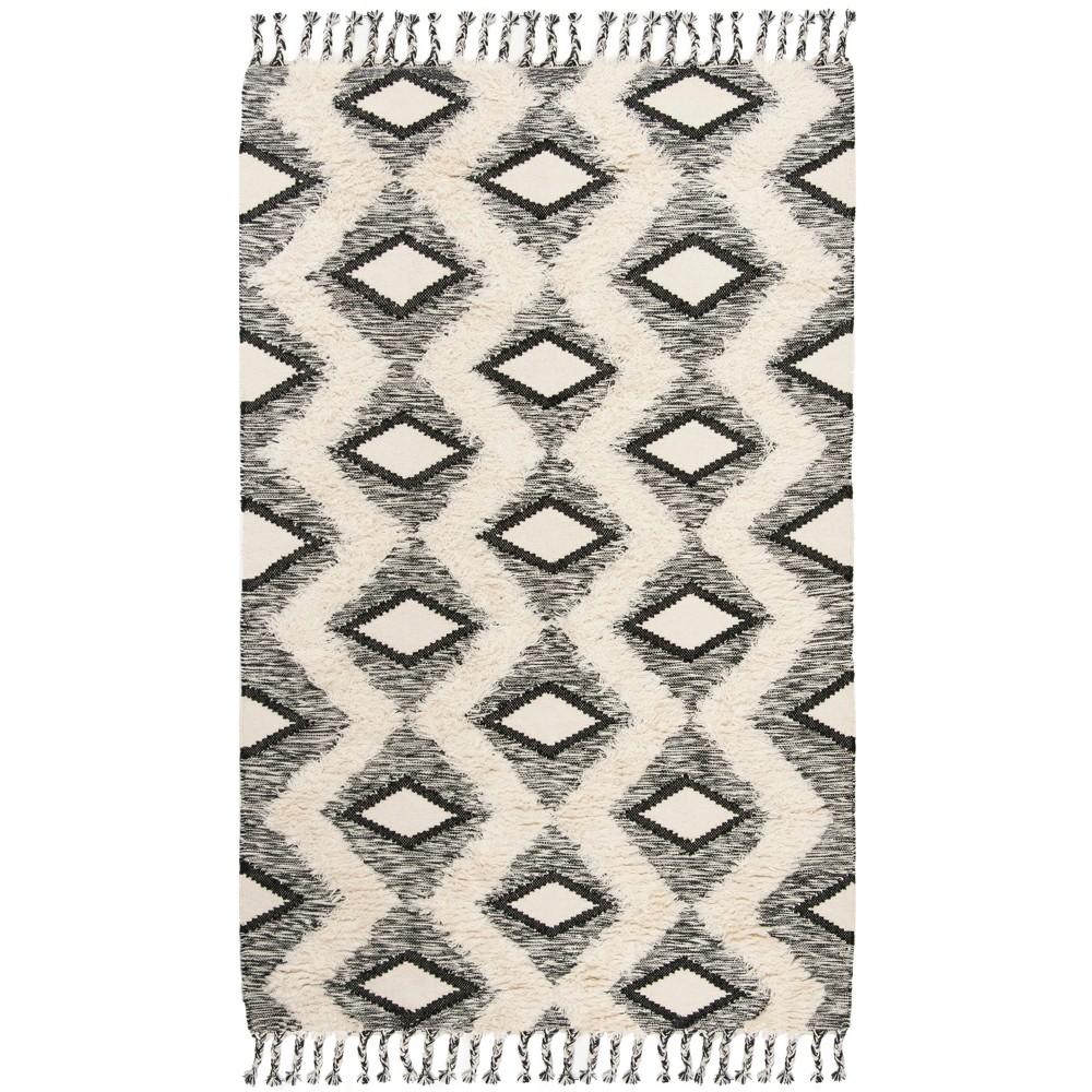 6'X9' Tribal Design Knotted Area Rug Black/Ivory - Safavieh