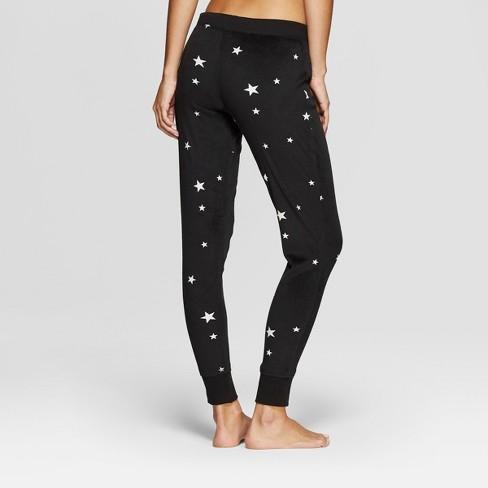 81b655e6fc7b Women s Cozy Fleece Star Pajama Pants - Xhilaration™ Black S   Target