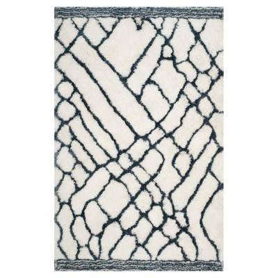 Ivory/Blue Abstract Tufted Area Rug - (5'x8')- Safavieh