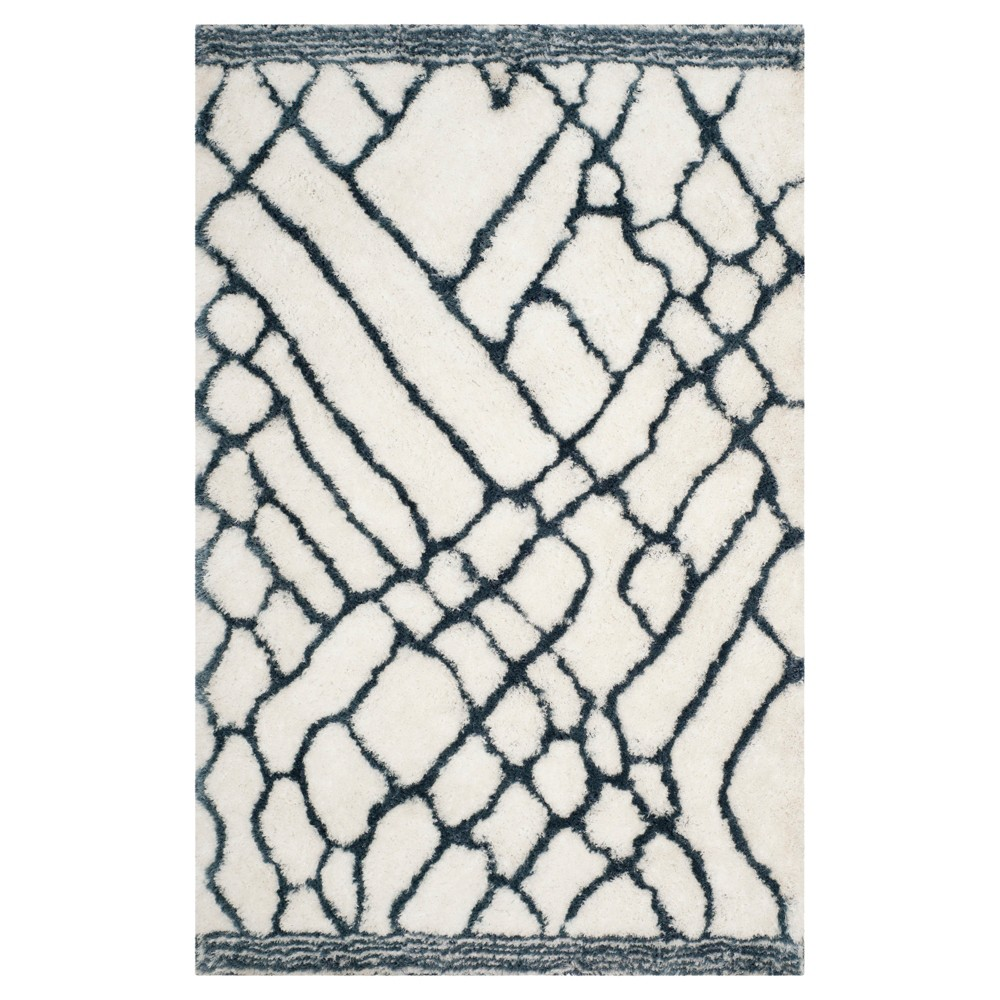 Ivory/Blue Abstract Tufted Area Rug - (5'x8') - Safavieh
