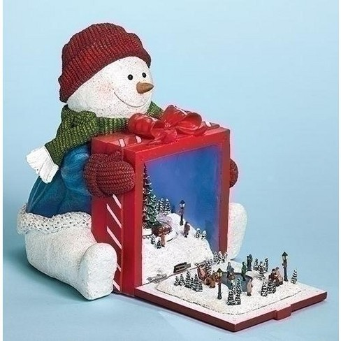 """Roman 8"""" Red and White Snowman Holding Gift with Rotating Train Musical Christmas Figure - LED Lights - image 1 of 1"""
