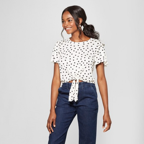 Women's Polka Dot Short Sleeve Tie Front Ruffle Shoulder Top - Lily Star (Juniors') Ivory - image 1 of 2