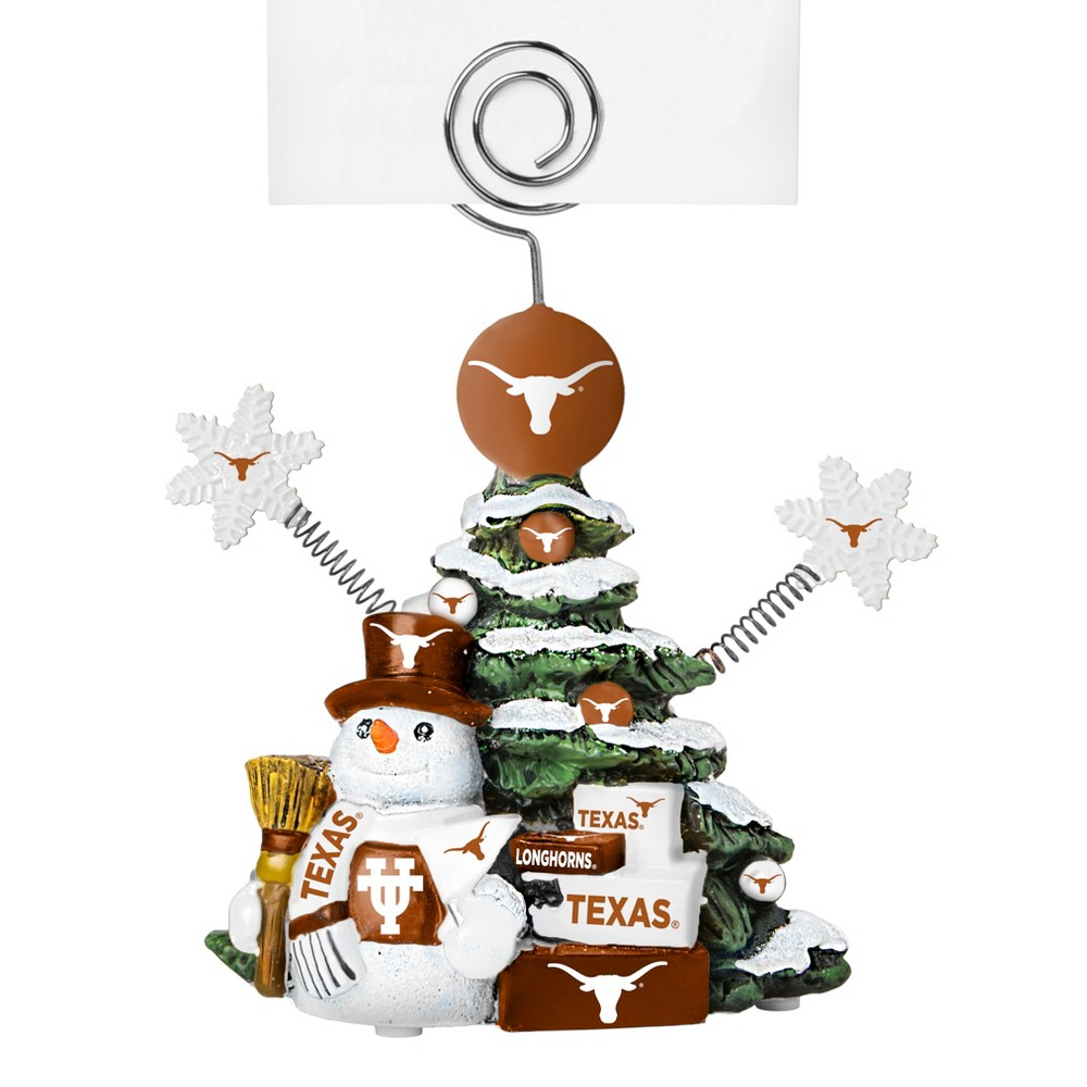Texas Longhorns Tree Photo Holder Beautifully detailed cold cast porcelain tree with snowman and presents. Decorated with colofrul team graphics, this table sop holder is great for holding photos, notes to santa or place cards. Stands 5 tall Color: Texas Longhorns. Age Group: Adult.