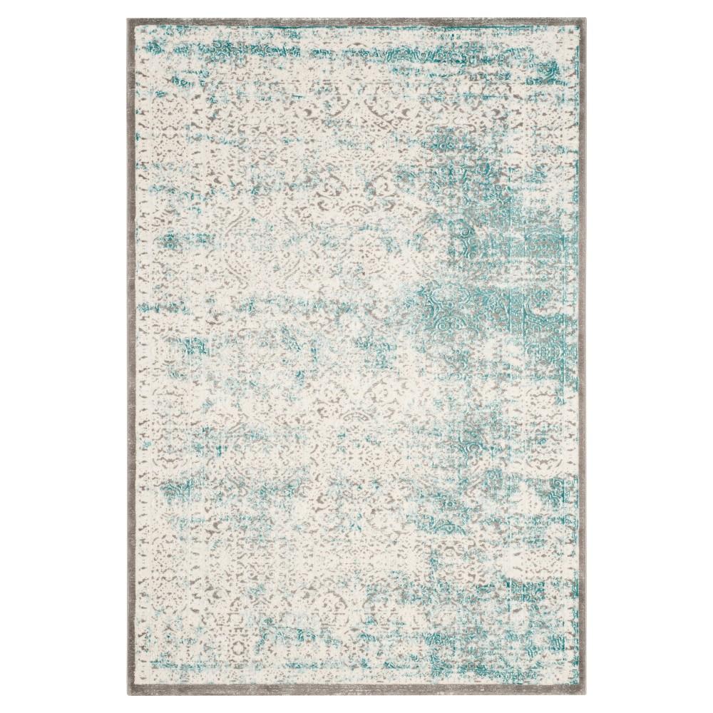 Banha Area Rug - Turquoise / Ivory (5'1