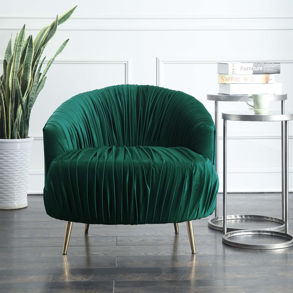 Penelope Accent Chair Emerald (Green) - Picket House Furnishings The Picket House Furnishings Penelope Accent Chair is where modern meets glam! This statement making chair features ruching throughout in a rich, velvet fabric. The fabric on the chair is ruched all along the front and back, adding extra drama and flair to this already stunning accent char. Gold, stainless tapered legs give this chair its modern vibe. Color: Emerald. Gender: Unisex. Pattern: Solid.