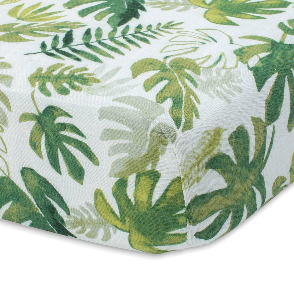 Image of Little Unicorn Cotton Muslin Fitted Crib Sheet - Tropical Leaf