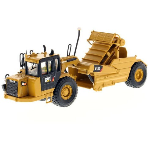 """CAT Caterpillar 613G Wheel Scraper with Operator """"High Line Series"""" 1/50 Diecast Model by Diecast Masters - image 1 of 4"""