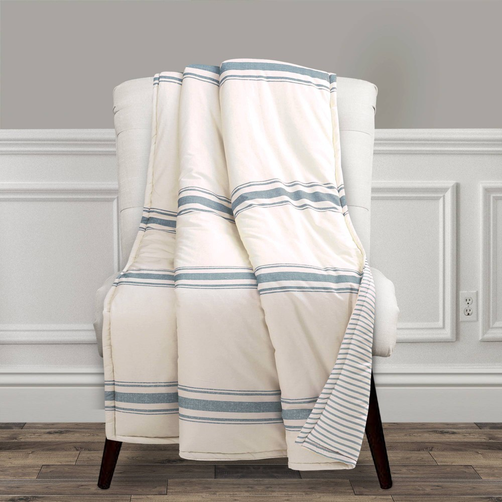 There is no easier way to add traditional farmhouse style to your home than with this Farmhouse Stripe Throw. The printing on the front looks almost like shiplap beams. The back features a thinner pinstripe print. This Farmhouse Stripe Throw would look great on a bed or sofa. Being reversible, you get two great looks in one. Each side brings its own unique style to your space. The Farmhouse Stripe Throw measures 60 inches long by 50 inches wide. It?s the perfect size for a single adult to use as a blanket or for two adults to snuggle in together. It can also be used as the main blanket on a small child\\\'s bed. This throw cleans up easily, as it is safe to machine wash and tumble dry on a low setting. Please read all instructions on the label before washing. Part of the Farmhouse Stripe Collection. Size: 50x60 inches.