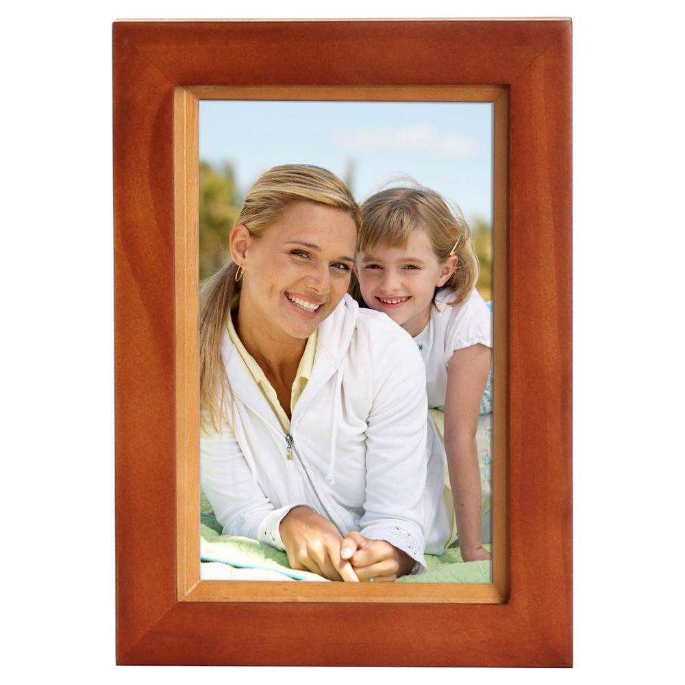 Frame Set Walnut (Brown) 4 x6  4pk - Uniek Muse 4x6 walnut brown and natural wood picture frames are packaged conveniently in a set of 4. The classic two toned finish of these photo frames will display your pictures in beautiful contemporary style. Each of these picture frames holds one photo, is constructed with hooks already attached for wall display and an easel for tabletop display, and can be displayed horizontally or vertically.