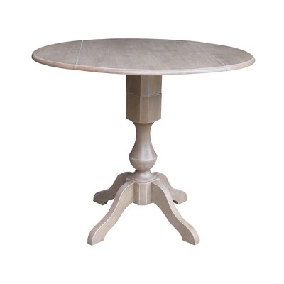 Kayden Round Dual Drop Leaf Pedestal Table Washed Gray Taupe - International Concepts