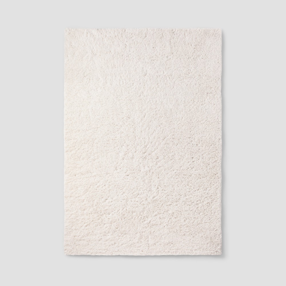 Cream (Ivory) Solid Tufted Washable Area Rug 7'X10' - Room Essentials