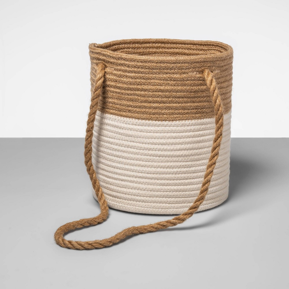 Enhance your storage needs with this White Coiled Rope Basket from Opalhouse?. This decorative basket makes a practical addition to organize any room, and will provide years of durable use in your home. Featuring a two-tone coiled construction, it brings a nice hint of texture and stylish design. This round-shaped basket can be used for storage purpose, as an attractive accent or as a hanging planter for your fresh greens. Finished with a rope handle for easy mobility around your home it can be placed in any room for versatile use. This is your house. Where you create spaces as bold as your spirit. Collect objects as inspired as your dreams. Find pieces that remind you of every place you?ve been. Discover stories to inspire everywhere you have yet to go. This is Opalhouse. Gender: unisex.