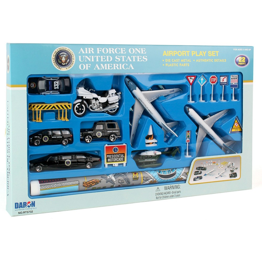 Daron Air Force One Die-Cast Playset - 20pc Create imaginative play setting with this Air Force One play set II die-cast planes, playmat and assorted vehicles. Die cast and plastic pieces. Incudes 20 pieces. Includes planes, limo, vehicles, motorcycle, helicopter, signs and play mat. Gender: unisex.