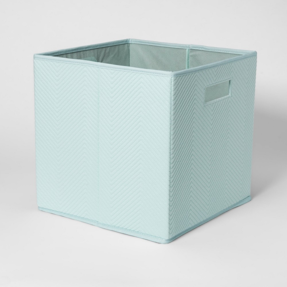 Fabric Cube Toy Storage Bin Aqua (Blue) - Pillowfort The Fabric Cube Storage Bin (13 x13 ) Mint and Cream from Pillowfort offers a stylish storage solution for clothing or small toys. It's perfect for a kids' room, home office, laundry room or craft room. Mix and match colors and prints for a creative look. Color: Aqua. Pattern: Chevron.