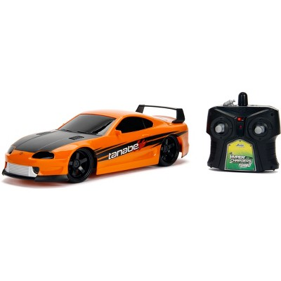 Jada Toys JDM Tuners RC 1995 Toyota Supra Remote Control Vehicle 1:16 Scale Metallic Orange
