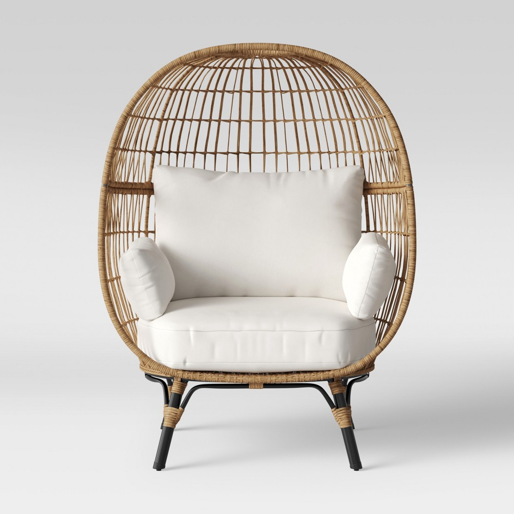 The Southport Patio Egg Chair from Opalhouse™ is a fun and unique addition to any outdoor living space. Large and visually interesting enough to stand on its own, it can also still fit into a larger arrangement with ease. This wicker egg chair with cushions supports you from every angle, making it the perfect place to curl up with a good book or podcast. This is your house. Where you create spaces as bold as your spirit. Collect objects as inspired as your dreams. Find pieces that remind you of every place you\\\'ve been. Discover stories to inspire everywhere you have yet to go. This is Opalhouse™. Color: Linen. Gender: unisex. Pattern: Solid.