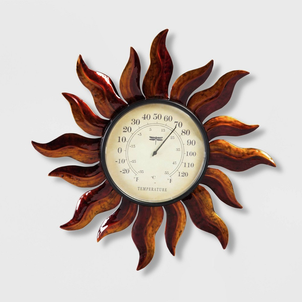 14 Metal Sun Outdoor Wall Thermometer Bronze - Evergreen, Brown Always be sure of what the temperature is when you're spending time outside by setting up the 14-inch Metal Sun Outdoor Wall Thermometer from Evergreen. This outdoor thermometer tells the temperature in both Fahrenheit and Celsius in large, easy-to-read numerals. The thermometer face is set into a beautiful bronze sun that makes the thermometer every bit as decorative as it is functional. Set up the wall-mount thermometer on the side of your house or on a trellis in your garden for an eye-catching display piece. Color: Brown.
