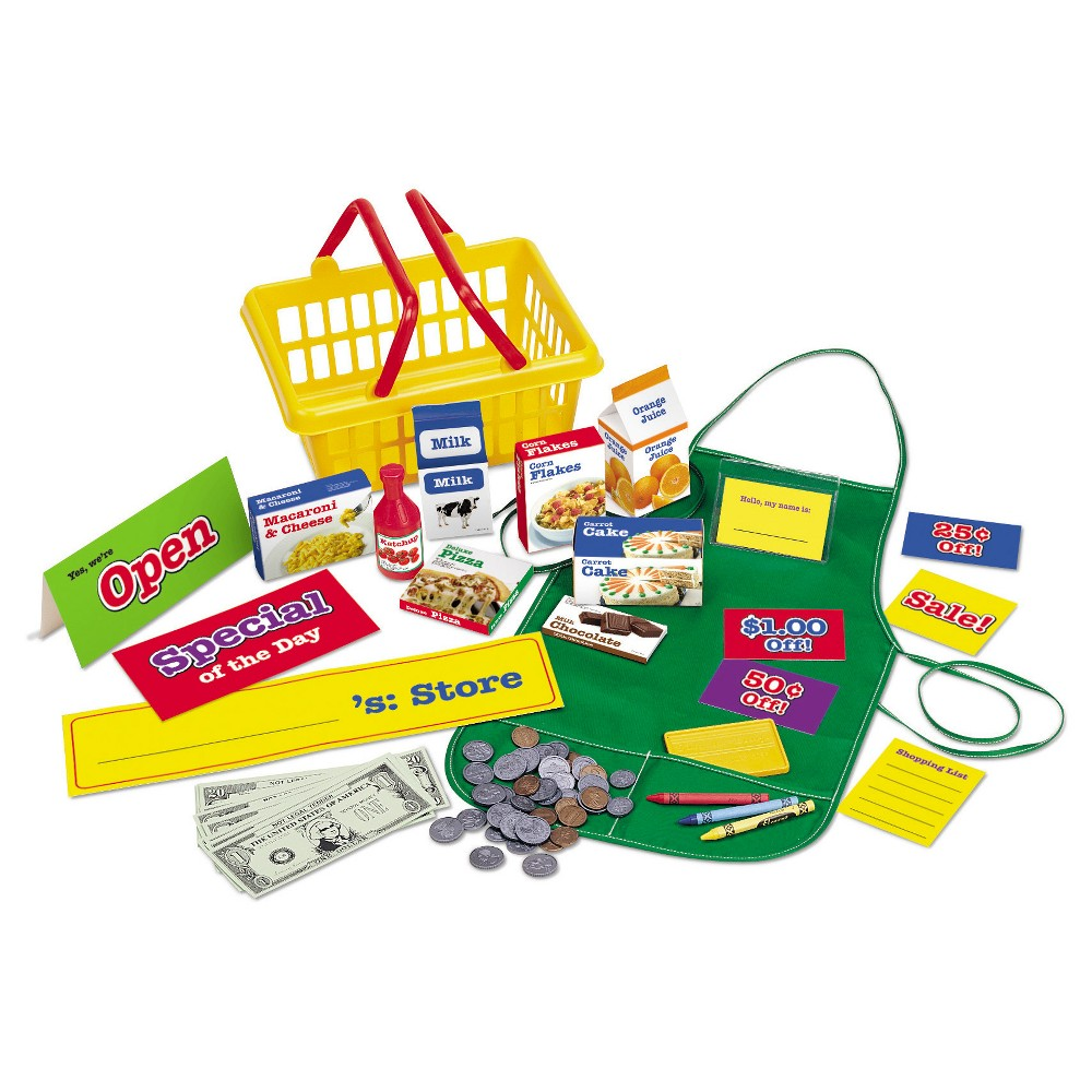 Learning Resources Pretend & Play Supermarket Set Complete with everything kids need for shopping role play! This 93-piece set includes a durable cotton apron with name tag, a shopping basket, groceries, assorted dry-erase sale signs, coupons, assorted plastic coins, paper play money, pretend credit card, and shopping lists. The perfect companion to Learning Resources cash registers! Shopping basket measures 1 ¾ L x 8 W. Ages 3+ Gender: unisex.