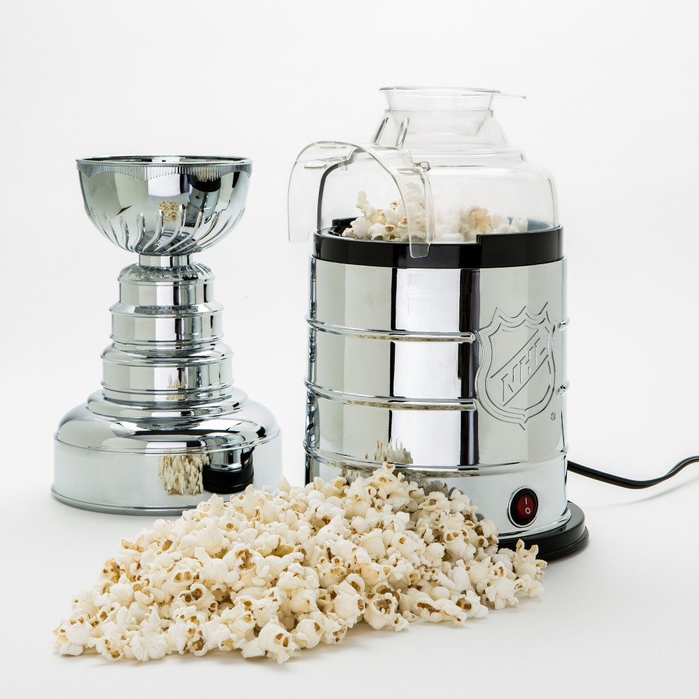 NHL Stanley Cup Popcorn Maker, Light Silver Many things have been consumed out of the bowl of the Stanley Cup: champagne, beer, cereal, coffee. But now popcorn? Behold the Stanley Cup Popcorn Popper, a 17-inch tall replica Stanley Cup that opens to reveal an air popper. The bowl of the Cup then transforms into a serving bowl for the popcorn. Snack like a champion! Color: Light Silver.