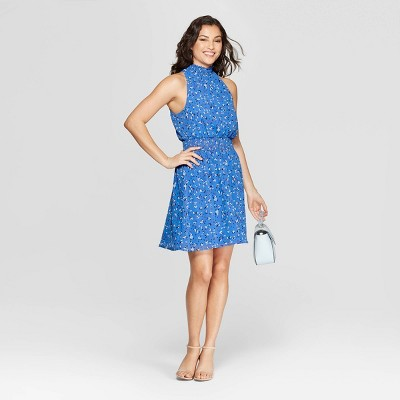 view Women's Floral Print Sleeveless Halter Neck Dress - A New Day Blue on target.com. Opens in a new tab.