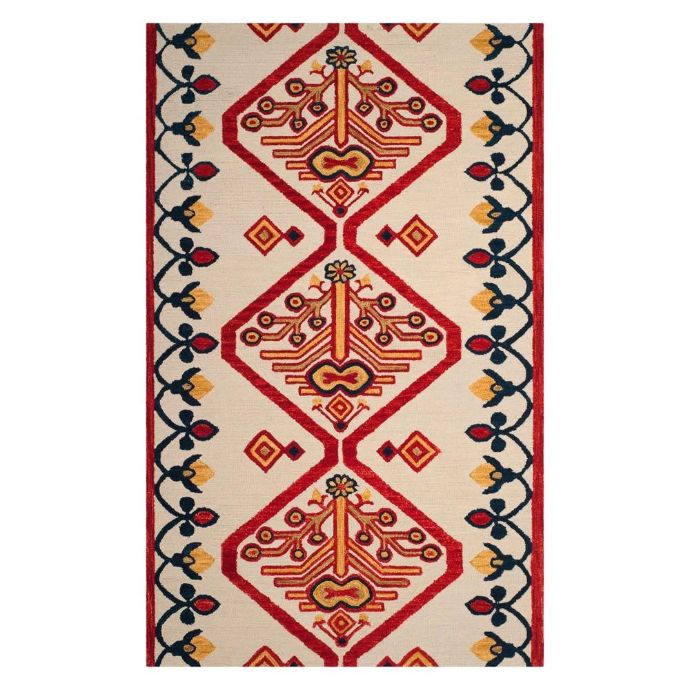 4'X6' Tribal Design Tufted Area Rug Ivory - Safavieh, Multicolored