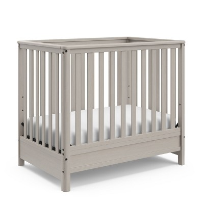 Motherly by Storkcraft Timeless 5-in-1 Convertible Mini Crib with Bonus Mattress