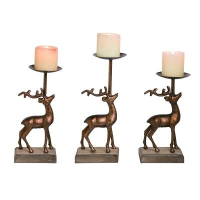 Transpac Metal 13 in. Bronze Christmas Reindeer Pillar Candle Holders Set of 3