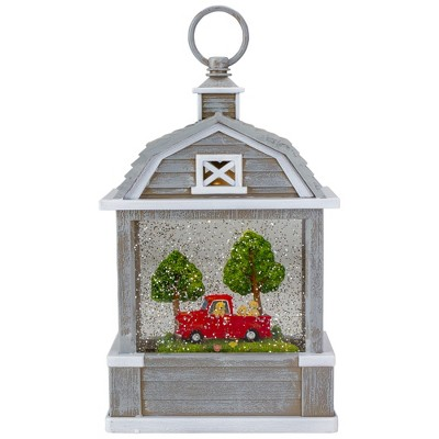 "Raz Imports 12.75"" Lighted Gray Barn Snow Globe with Red Truck and Dogs"