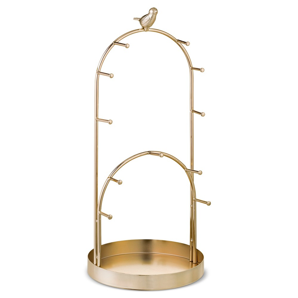 Arched Jewelry Storage Stand with Bird Gold - West Emory With its double arched construction, this jewelry stand is both beautiful and functional. The tall bar features 6 pegs with a small bird on top. The small bar has 5 pegs for the shorter lovelies. The bottom tray serves as the perfect catchall. Color: Gold. Gender: Unisex.