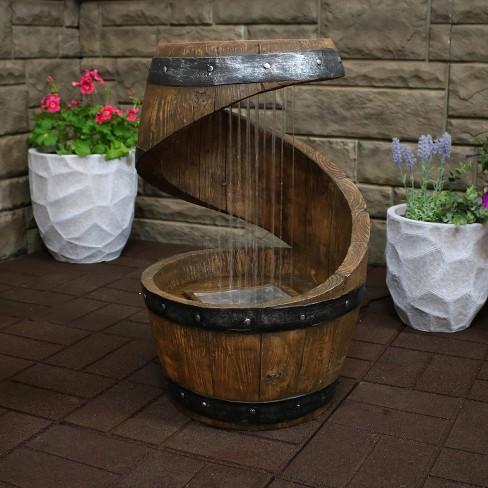 "24"" Spiraling Barrel Outdoor Water Fountain with LED Lights - Sunnydaze Decor - image 1 of 4"