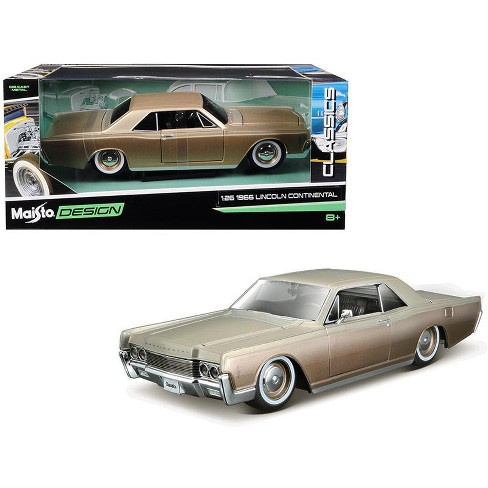 "1966 Lincoln Continental Gold ""Classic Muscle"" 1/26 Diecast Model Car by Maisto - image 1 of 1"
