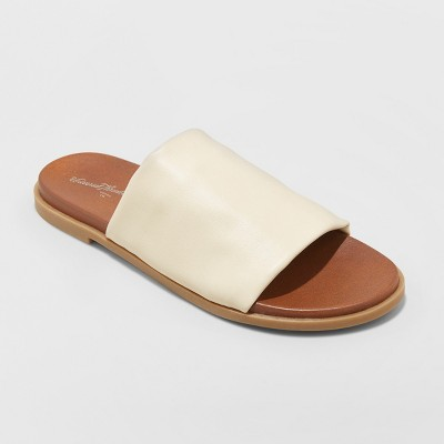 view Women's Gigi Hooded Slide Sandals - Universal Thread on target.com. Opens in a new tab.
