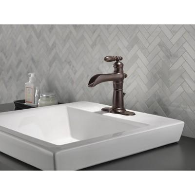 Delta Faucet 554LF Victorian Single Hole Waterfall Bathroom Faucet