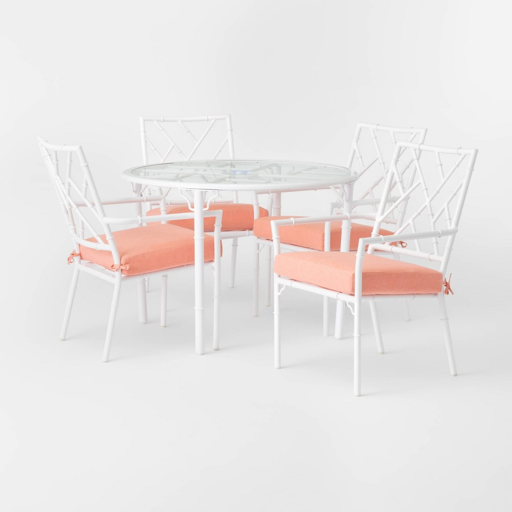 The Pomelo Patio Dining Set from Opalhouse? will let you enjoy leisurely time and meals with family and friends in your outdoor space. The white metal dining set features a durable, rust-resistant frame in a simple, chic design that offers functionality and style to your decor. This five-piece furniture set includes four armchairs and a round dining table with tempered-glass tabletop. The chair backs are designed with an eye-catching open-geometric pattern that\\\'s matched with the pattern on the glass-tabletop of the dining table for breezy, coastal flair. The chairs have orange seat cushions to offer soft, padded comfort while you sit back and dine, and they fill your space with a burst of bright color. This is your house. Where you create spaces as bold as your spirit. Collect objects as inspired as your dreams. Find pieces that remind you of every place you?ve been. Discover stories to inspire everywhere you have yet to go. This is Opalhouse. Gender: unisex.